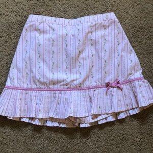 Pink gathered skort with rosebud pattern stripes